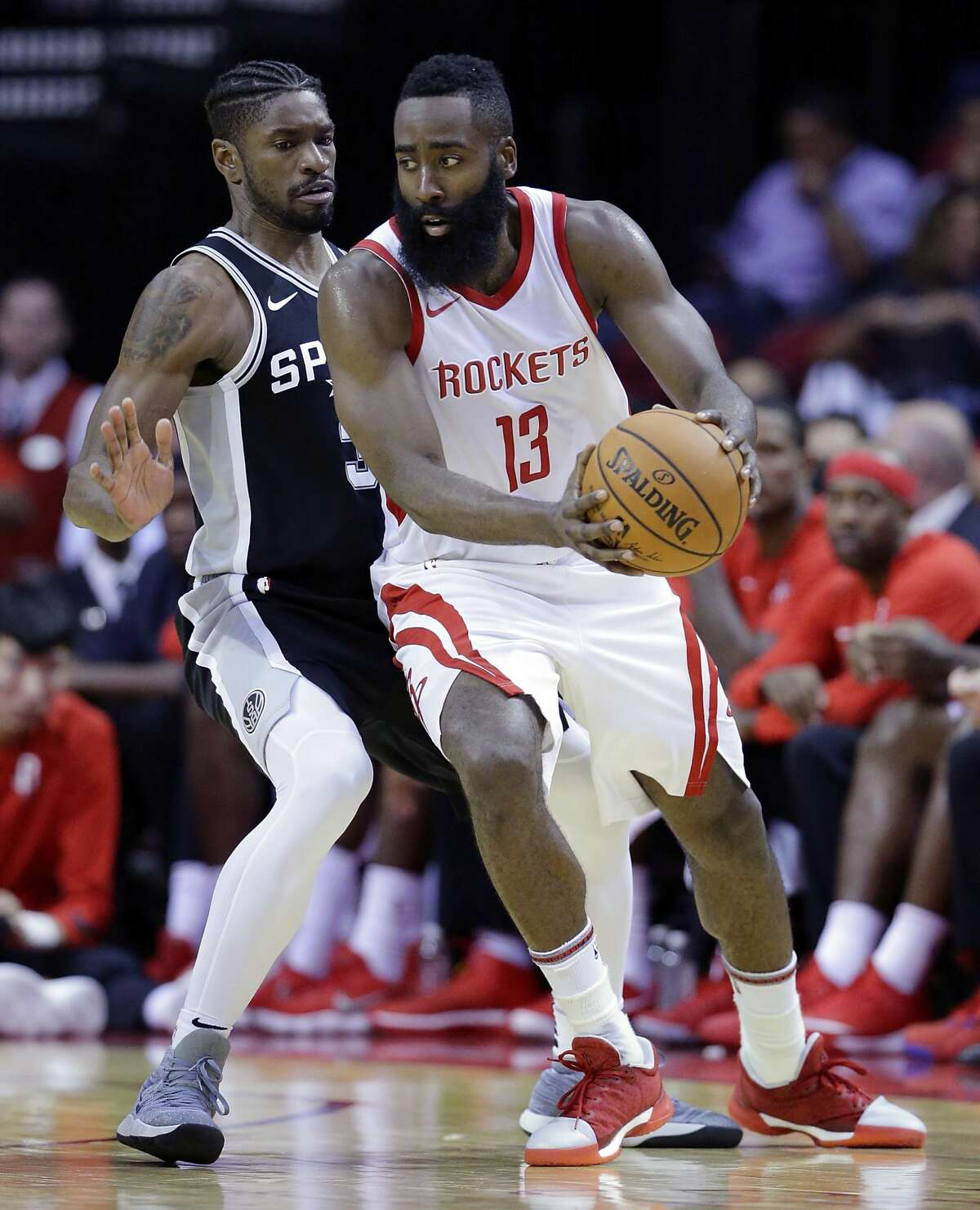 San Antonio Spurs guard Brandon Paul (3) defends as Houston Rockets guard James Harden (13) drives around him in the second half of an NBA preseason basketball game Friday, Oct. 13, 2017, in Houston. (AP Photo/Michael Wyke)