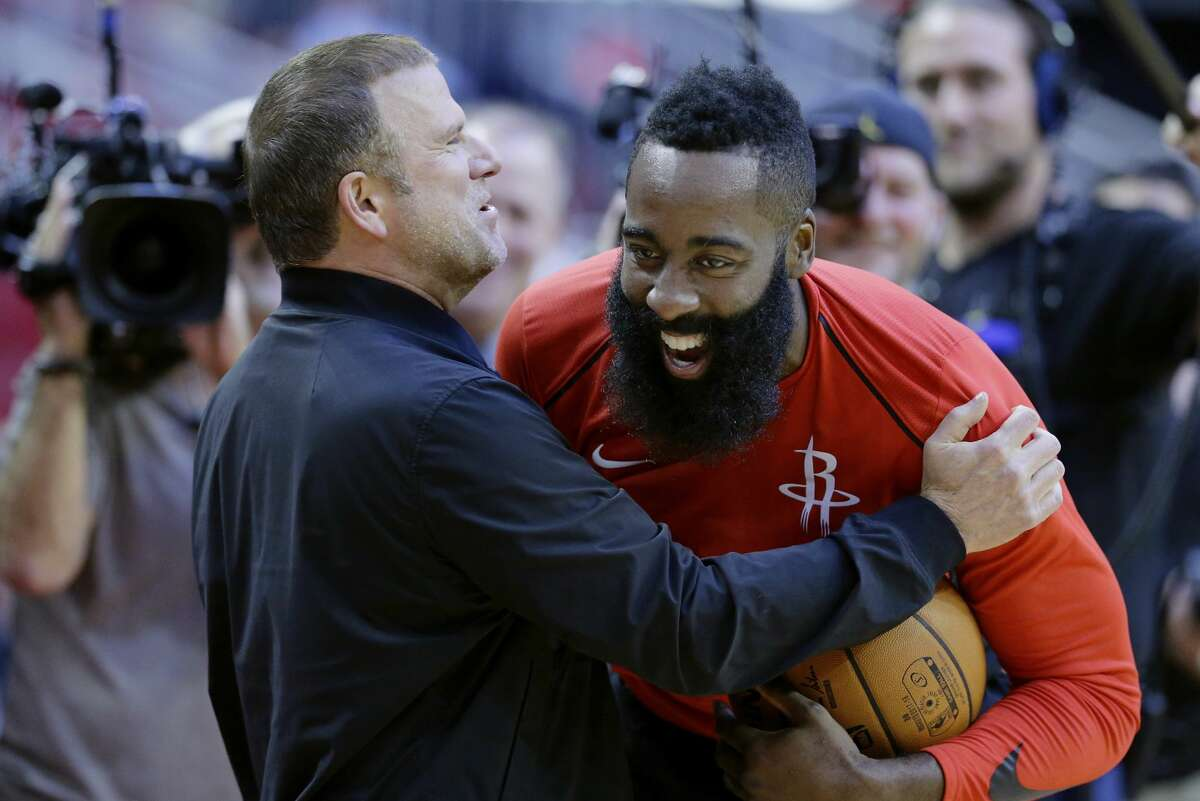 The new owner of the Houston Rockets Tilman Fertitta shares a laugh with his player James Harden before their game against the San Antonio Spurs in an NBA preseason basketball game Friday, Oct. 13, 2017, in Houston. (AP Photo/Michael Wyke)