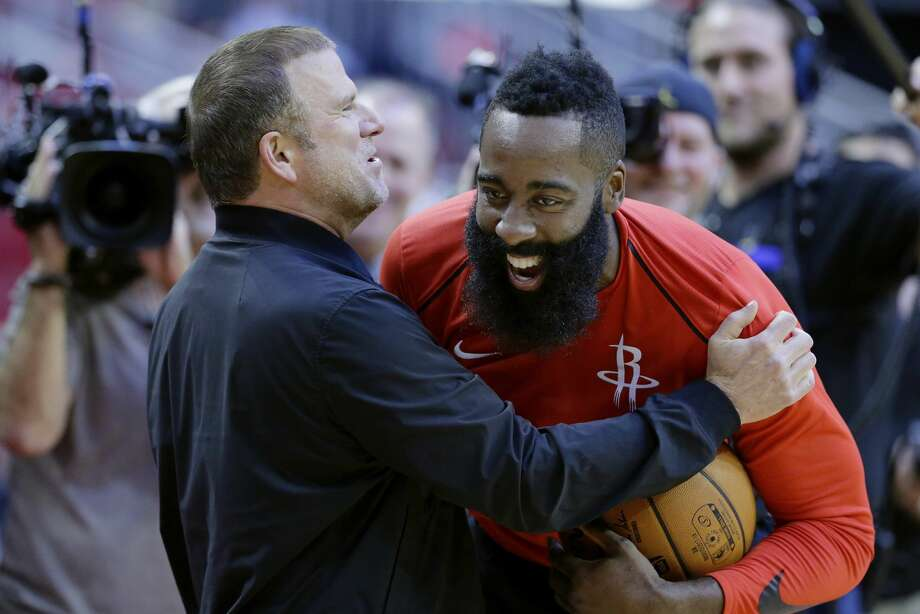 The new owner of the Houston Rockets Tilman Fertitta shares a laugh with his player James Harden before their game against the San Antonio Spurs in an NBA preseason basketball game Friday, Oct. 13, 2017, in Houston. (AP Photo/Michael Wyke) Photo: Michael Wyke/Associated Press