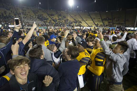 California fans rush the field after their team upset eighth-ranked Washington State in an NCAA college football game, Friday, Oct. 13, 2017, in Berkeley, Calif. Cal won 37-3. (AP Photo/D. Ross Cameron)