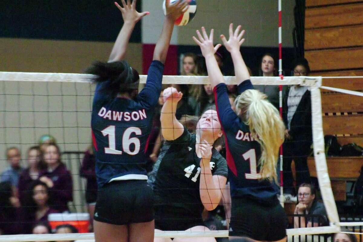 Pearland's Kaylie Kovach (41) Dawson's Aliyah McDonald (16) and Dawson's Katelynn Tripp (12) Friday, Oct 13 at Dawson High School.
