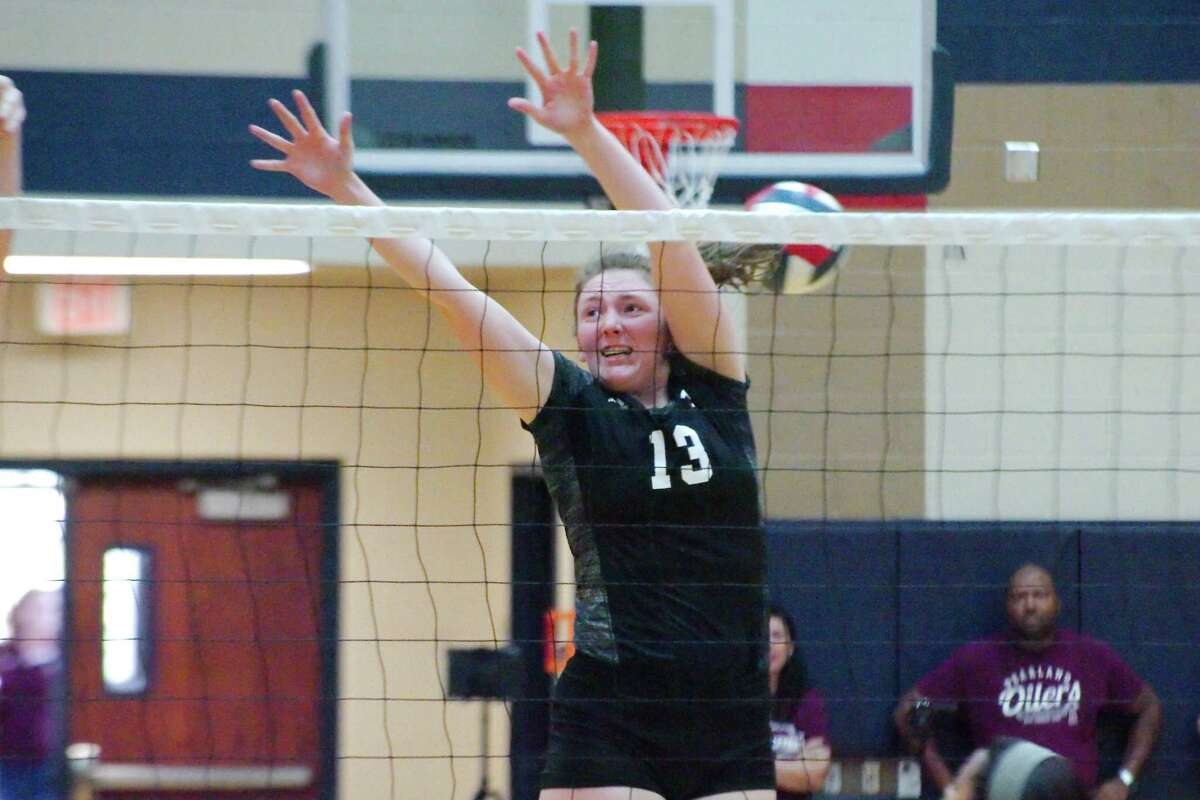 Pearland's Sam Demmon (13) goes high to block a shot from Dawson Friday, Oct 13 at Dawson High School.