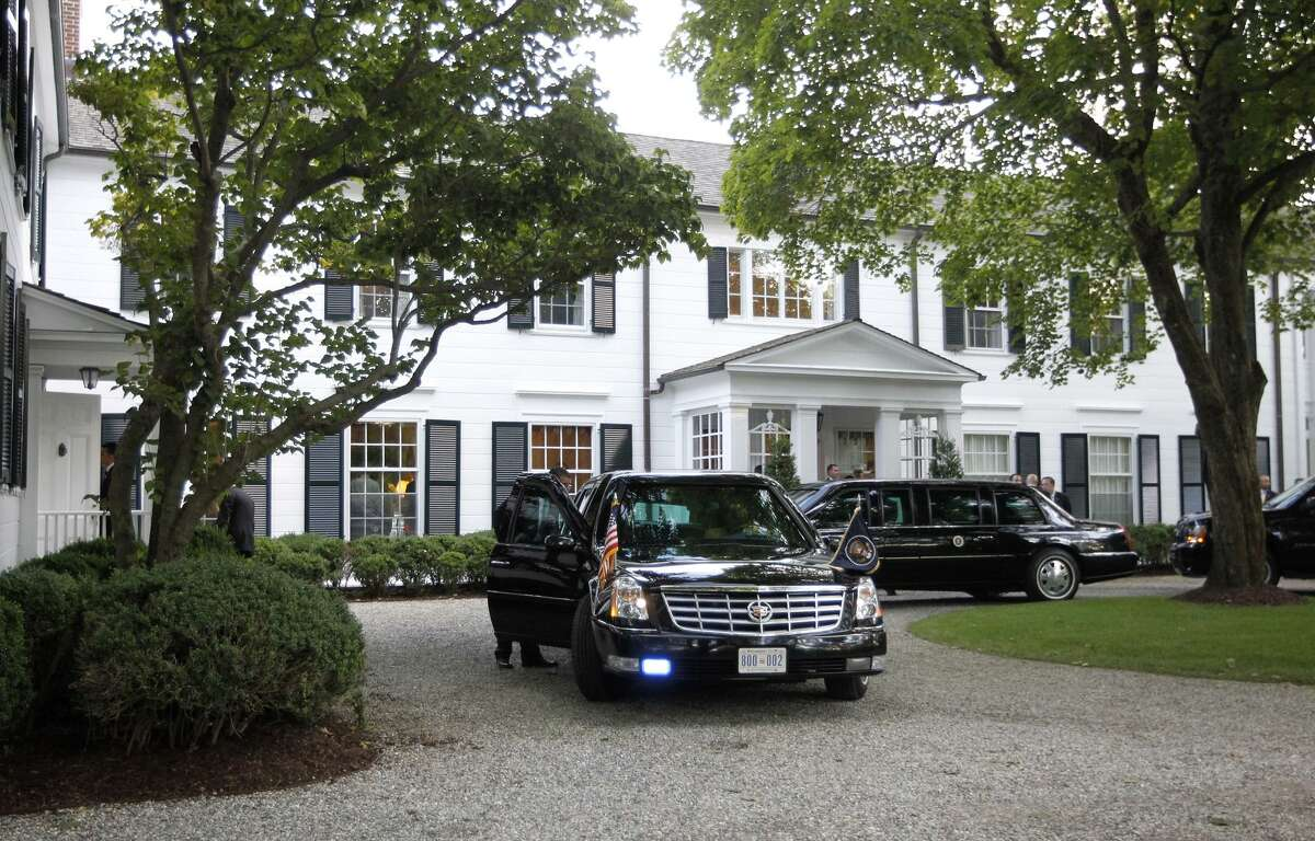 Limousines and motorcade vehicles for President Barack Obama are seen parked in the driveway outside the residence of movie producer Harvey Weinstein and fashion designer Georgina Chapman, Monday, Aug., 6, 2012 in Westport, Conn.