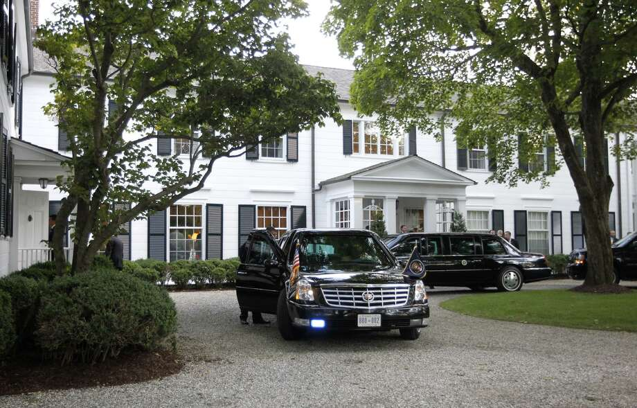 Limousines and motorcade vehicles for President Barack Obama are seen parked in the driveway outside the residence of movie producer Harvey Weinstein and fashion designer Georgina Chapman, Monday, Aug., 6, 2012 in Westport, Conn. Photo: AP Photo /Pablo Martinez Monsivais / Associated Press
