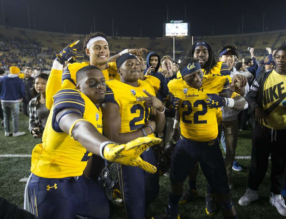 California players pose for a celebratory picture after their team upset eighth-ranked Washington State in an NCAA college football game, Friday, Oct. 13, 2017, in Berkeley, Calif. Cal won 37-3. (AP Photo/D. Ross Cameron) Photo: D. Ross Cameron, Associated Press