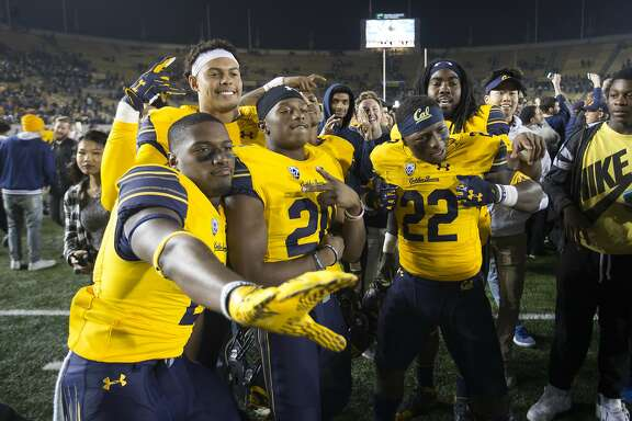 California players pose for a celebratory picture after their team upset eighth-ranked Washington State in an NCAA college football game, Friday, Oct. 13, 2017, in Berkeley, Calif. Cal won 37-3. (AP Photo/D. Ross Cameron)