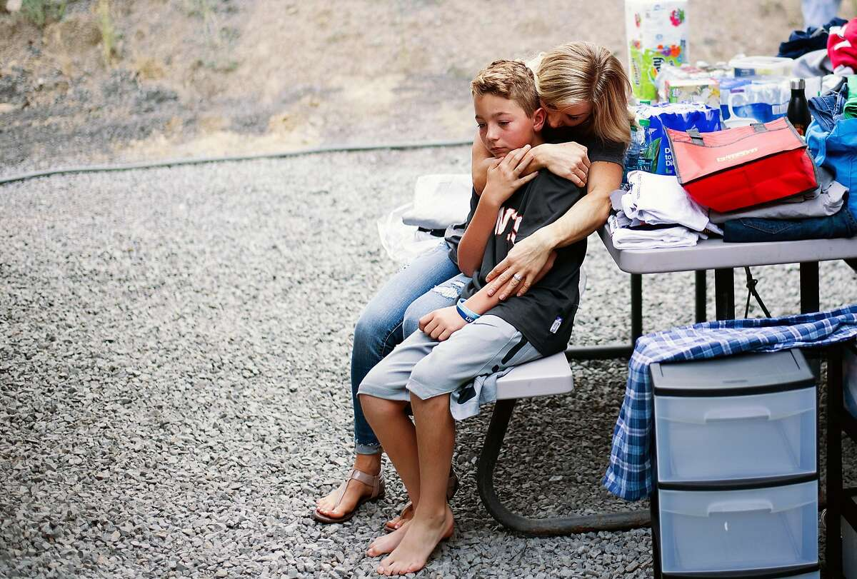 Felicia Ehni hugs son Dylan Ehni, 12, while settling into a temporary home in Forestville, Calif., on Friday, Oct. 13, 2017. Her family is staying in a motorhome after losing their Santa Rosa home during the Tubbs fire.