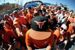 Texas fans wait outside the stadium for their team to arrive before an NCAA college football game against Oklahoma, Saturday, Oct. 14, 2017, in Dallas, Texas. (AP Photo/Ron Jenkins)