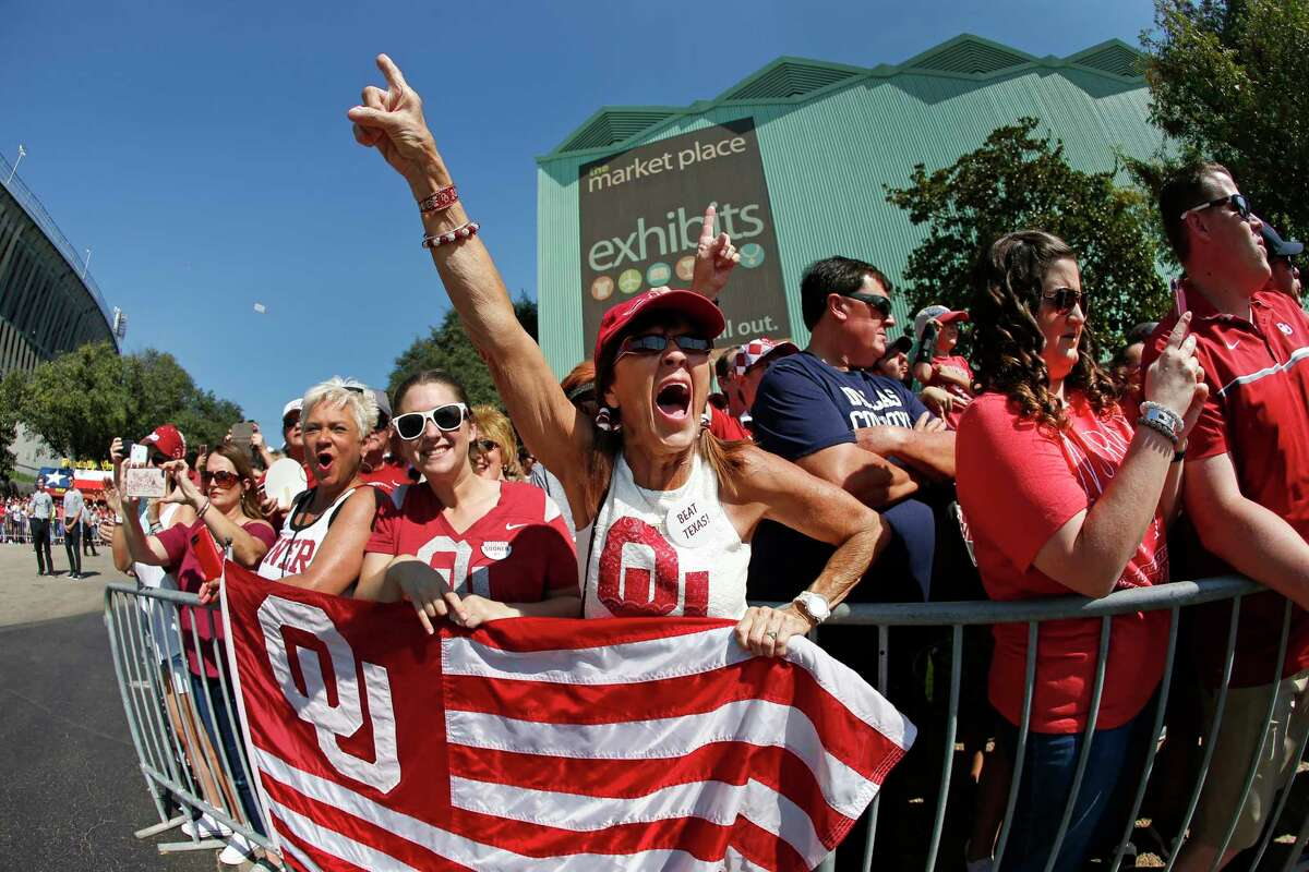 Oklahoma fans wait for their team to arrive outside the stadium before an NCAA college football game against Texas, Saturday, Oct. 14, 2017, in Dallas, Texas. (AP Photo/Ron Jenkins)