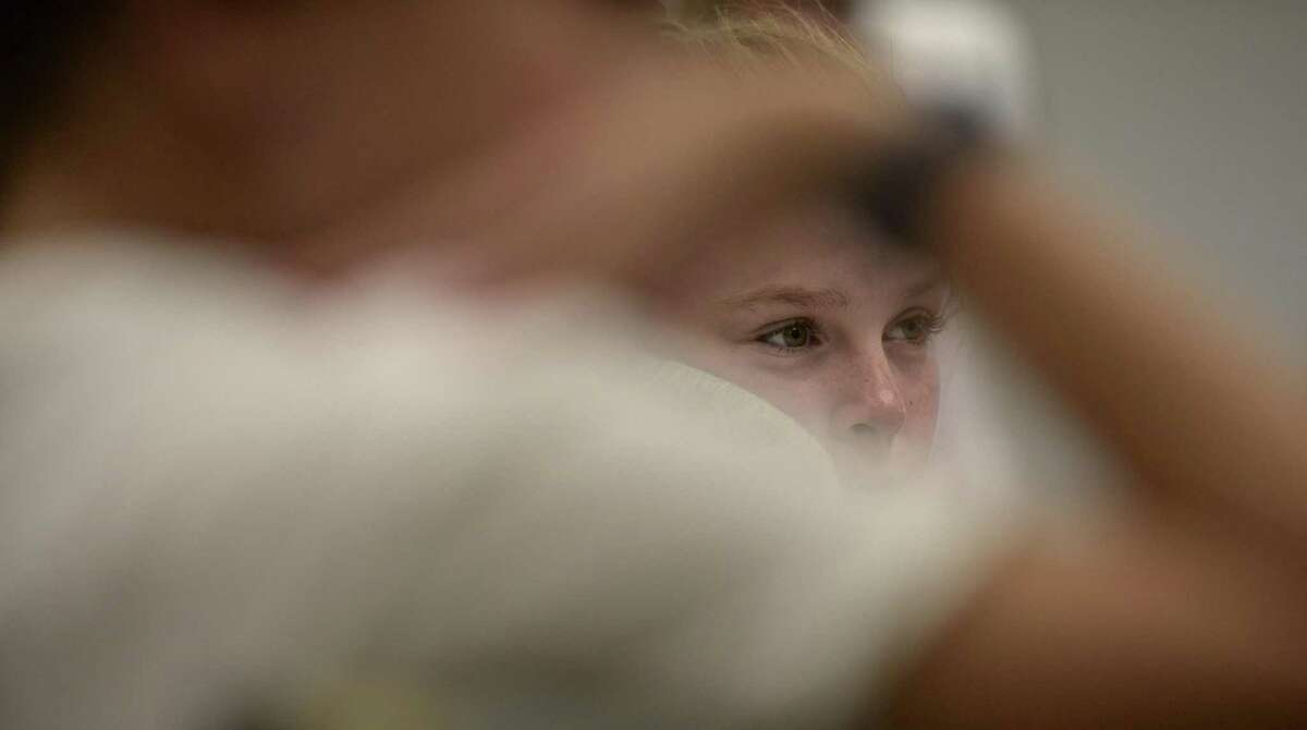 Zoe Gitlin listens to a speaker during a meeting of Ms President US on Friday afternoon. The organization is a nonprofit created after the 2016 election aims to teach girls 4th through 8th grade about civic engagement and leadership skills. Friday afternoon, October 13, 2017, in Ridgefield, Conn.
