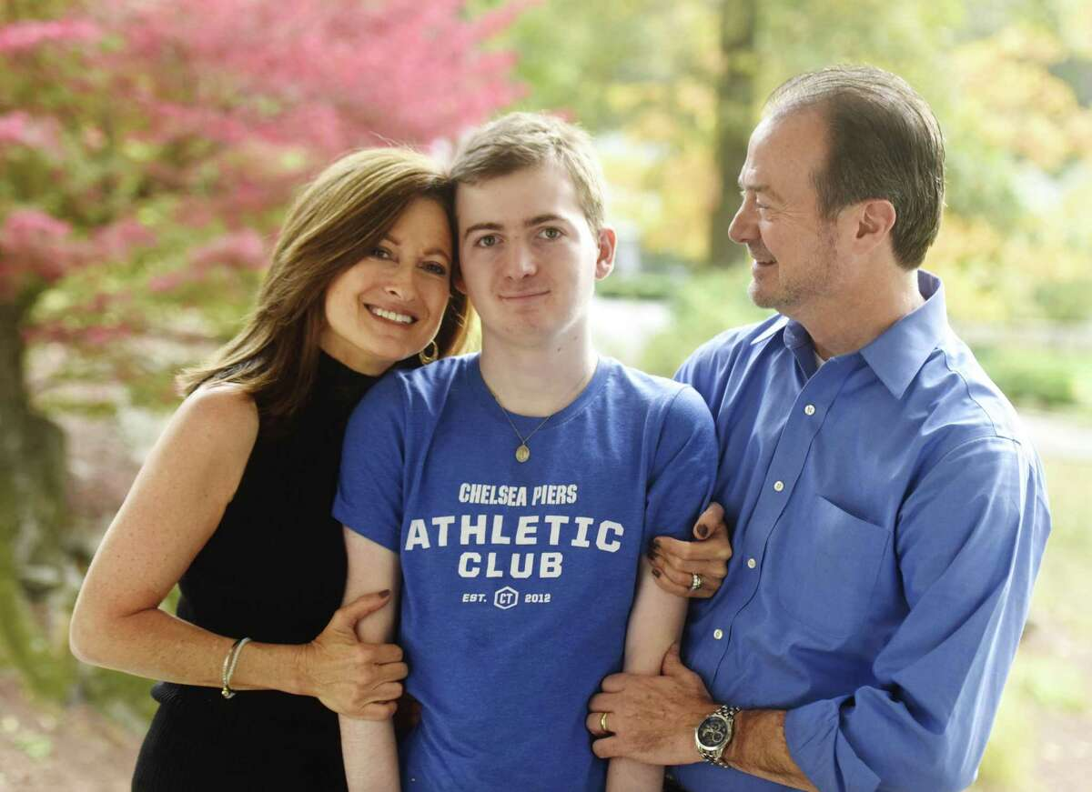 Andrea and Phil Marella pose with their son, Andrew, 18, at their home in Greenwich, Conn. Wednesday, Oct. 11, 2017. Andrew has a rare progressive genetic disorder called Niemann-Pick disease type C (NPC), which took the life of his sister, Dana, in 2013. The Marella's non-profit Dana?'s Angels Research Trust (DART), raises money to research the disease and is holding a benefit concert featuring country music star Hunter Hayes at The Palace Theatre in Stamford on Nov. 11.