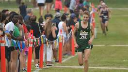 Holmes Ethan Hageman heads to the finish line to win the boys varsity District 28-6A cross country championship Saturday morning at the Alamo Golf Club.
