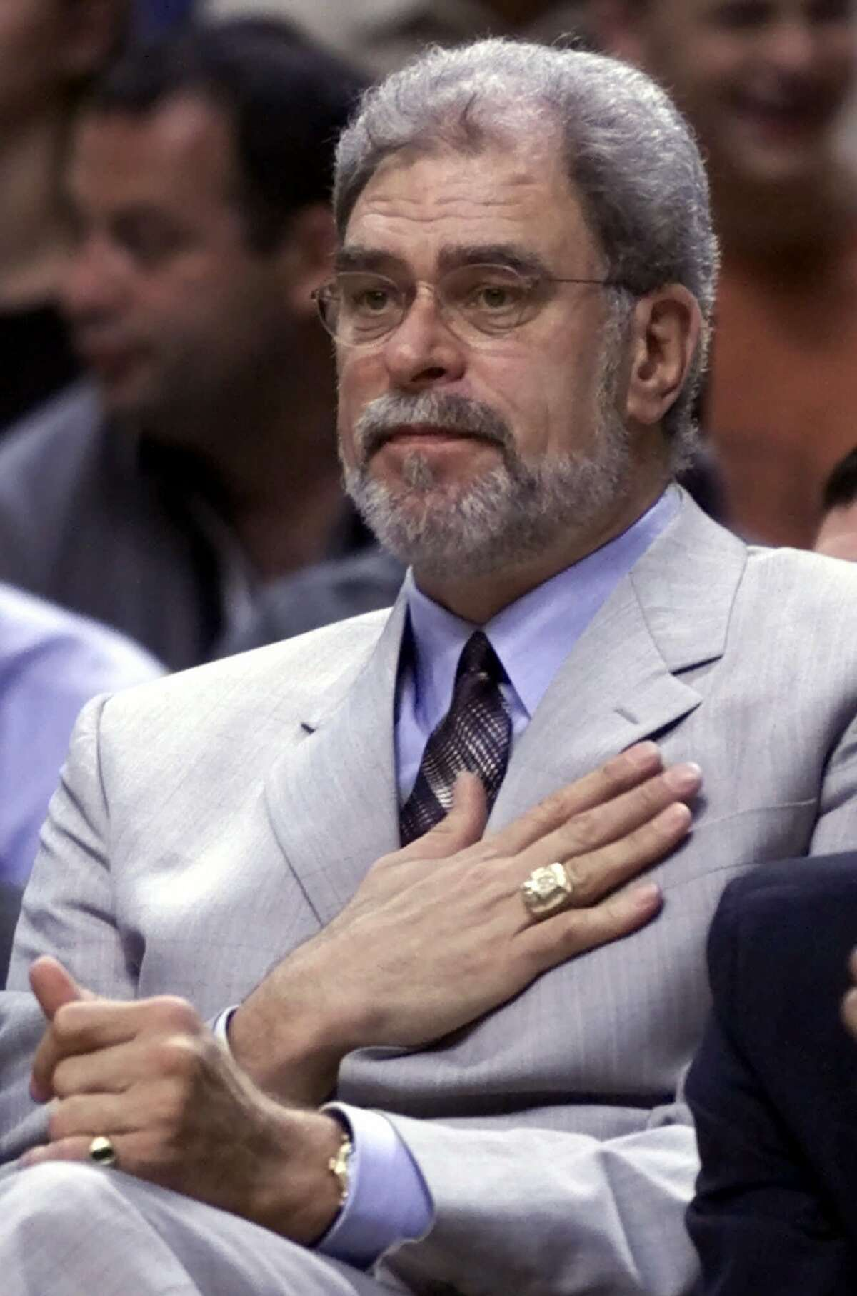 Los Angeles Lakers head coach Phil Jackson puts his hand over his heart as he watchs third quarter action against the Indiana Pacers in game five of the NBA Finals in Indianapolis, Firday, June 16, 2000. (AP Photo/Michael Conroy)