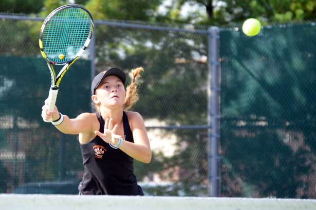 Edwardsville's Grace Desse makes a play at the net during her doubles semifinal match with Abby Cimarolli against Belleville East on Saturday.
