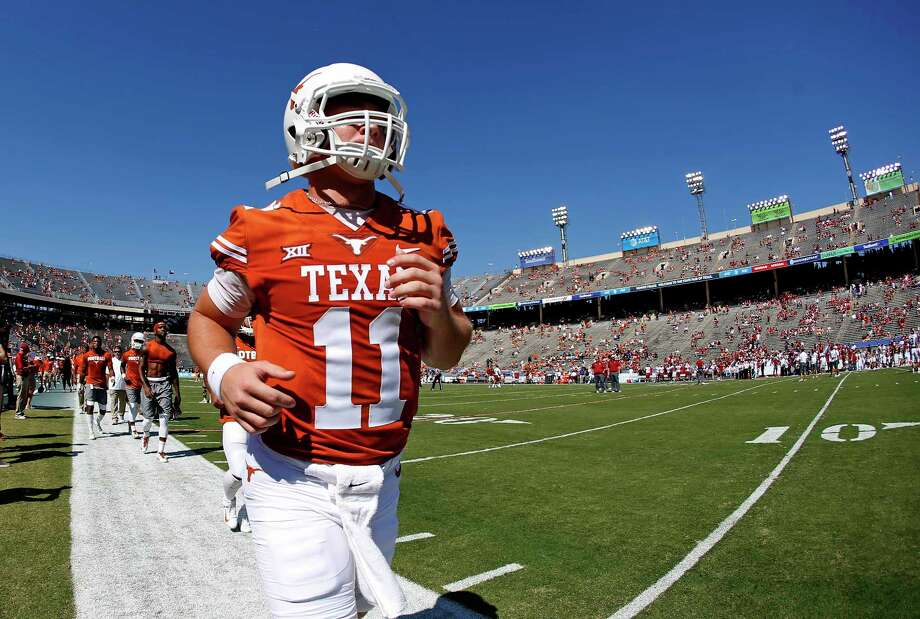 Texas quarterback Sam Ehlinger (11) warms up before playing Oklahoma in an NCAA college football game Saturday, Oct. 14, 2017, in Dallas, Texas. (AP Photo/Ron Jenkins) Photo: Ron Jenkins, Associated Press / FR171331 AP