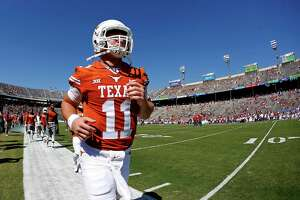 Texas quarterback Sam Ehlinger (11) warms up before playing Oklahoma in an NCAA college football game Saturday, Oct. 14, 2017, in Dallas, Texas. (AP Photo/Ron Jenkins)