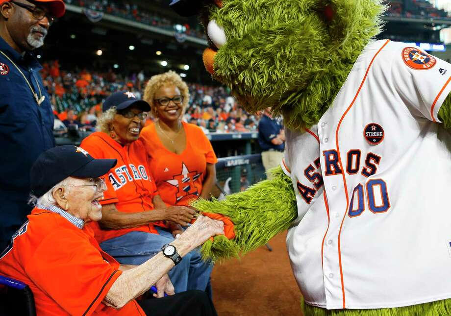 Walter Peine, who turns 102 next week, meets with Orbit along with fellow ceremonial first-pitch-thrower Maxine Williams, also 101, before the start of Game 2 of the ALCS at Minute Maid Park on Saturday, Oct. 14, 2017, in Houston. Photo: Brett Coomer, Houston Chronicle / © 2017 Houston Chronicle