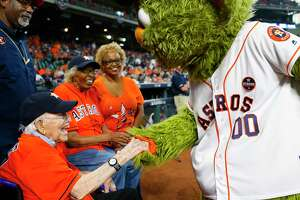 Walter Peine, who turns 102 next week, meets with Orbit along with fellow ceremonial first-pitch-thrower Maxine Williams, also 101, before the start of Game 2 of the ALCS at Minute Maid Park on Saturday, Oct. 14, 2017, in Houston.