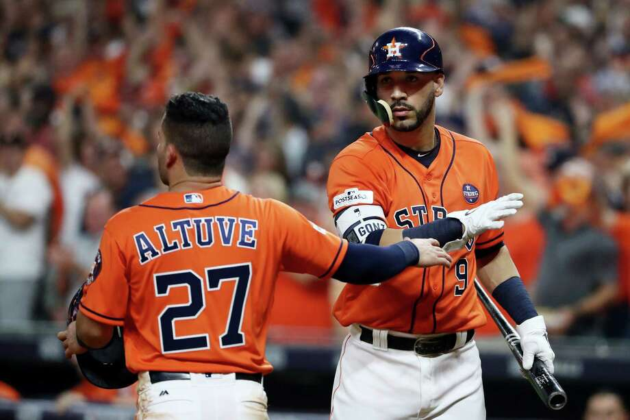 HOUSTON, TX - OCTOBER 13:  Jose Altuve #27 of the Houston Astros celebrates with Marwin Gonzalez #9 after scoring on a single by Carlos Correa #1 in the fourth inning against the New York Yankees during game one of the American League Championship Series at Minute Maid Park on October 13, 2017 in Houston, Texas.  (Photo by Elsa/Getty Images) Photo: Elsa, Staff / 2017 Getty Images