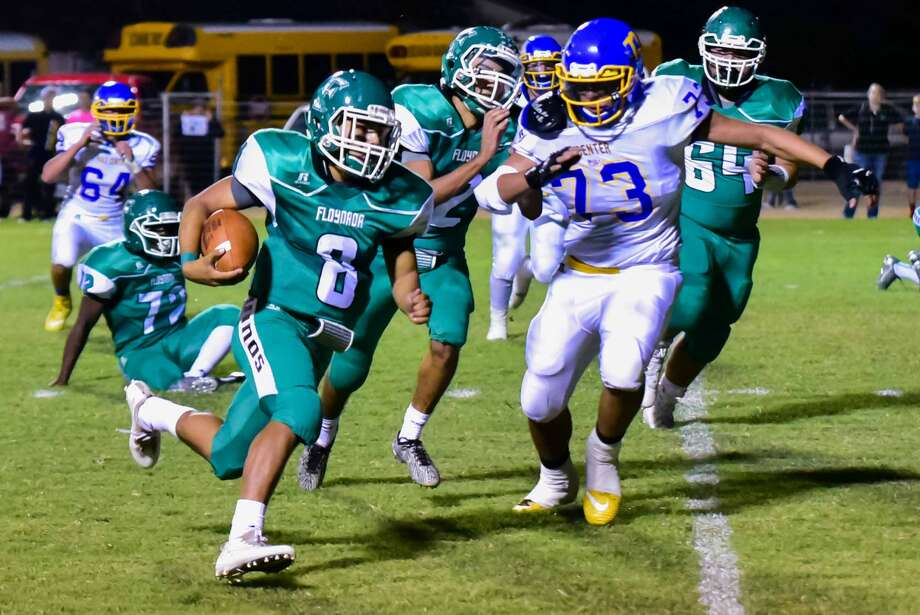 Floydada quarterback Andrew Vega, 8, turns the corner and gains yardage as Hale Center defensive lineman Quentin Bendele, 73, tires to catch him during a District 2-2A, Division I game at Floydada Friday night. Photo: Photo Courtesy Of Albert Gomez Photography