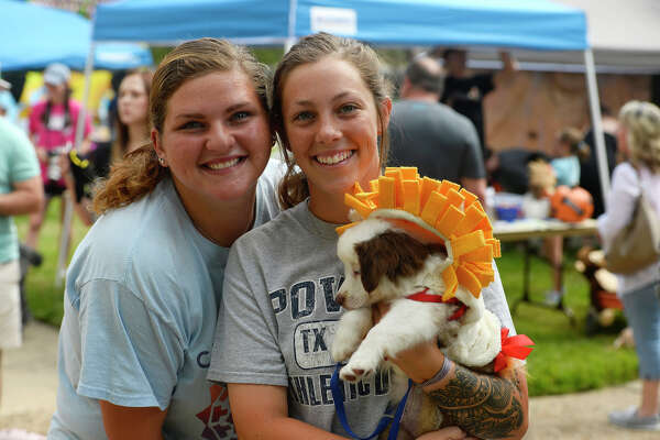 Makenna Cowart and Madey Greene with a miniature Australian shepherd puppy during Dogtoberfest in downtown Beaumont on Saturday.  Photo taken Saturday 10/14/17 Ryan Pelham/The Enterprise