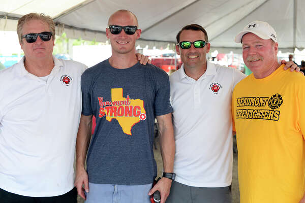 "Ted Hillin, Cody Hendon, Jeff Nesom and Galen Key during the Beaumont Professional Firefighters Local 399's ""Beaumont Strong"" barbecue sale on Saturday. The fire union held the event to raise money for city employees who didn't have flood insurance when Tropical Storm Harvey damaged their property. Photo taken Saturday 10/14/17 Ryan Pelham/The Enterprise"