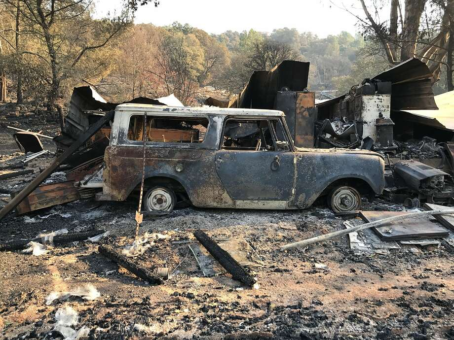 Kevin Trainor surveys the wreckage of his cousin's property on Wood Valley Road, just east of Sonoma. Trainor kept his dogs and cats at the property and restored old motorcycles in a garage there. Photo: Catherine Ho