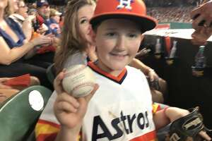 Twelve-year-old Carson Riley from Liberty Hill came away with Carlos Correa's home run ball after nearly interfering with Yankees right fielder Aaron Judge during Saturday's Game 2 at Minute Maid Park.