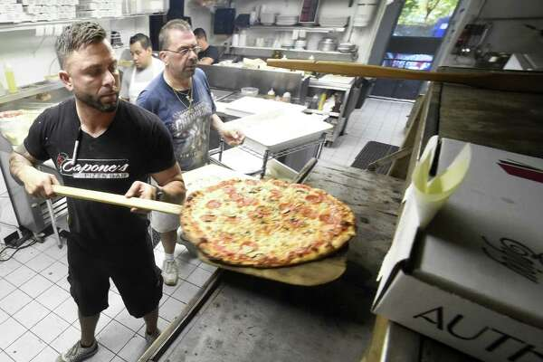 New Haven, Connecticut - Friday, October 6, 2017:  Owner Nick Capone, left, and pizza maker Angelo DeCicco, right, man the ovens at  Capone's Pizza Bar on Foxon Road in North Branford.