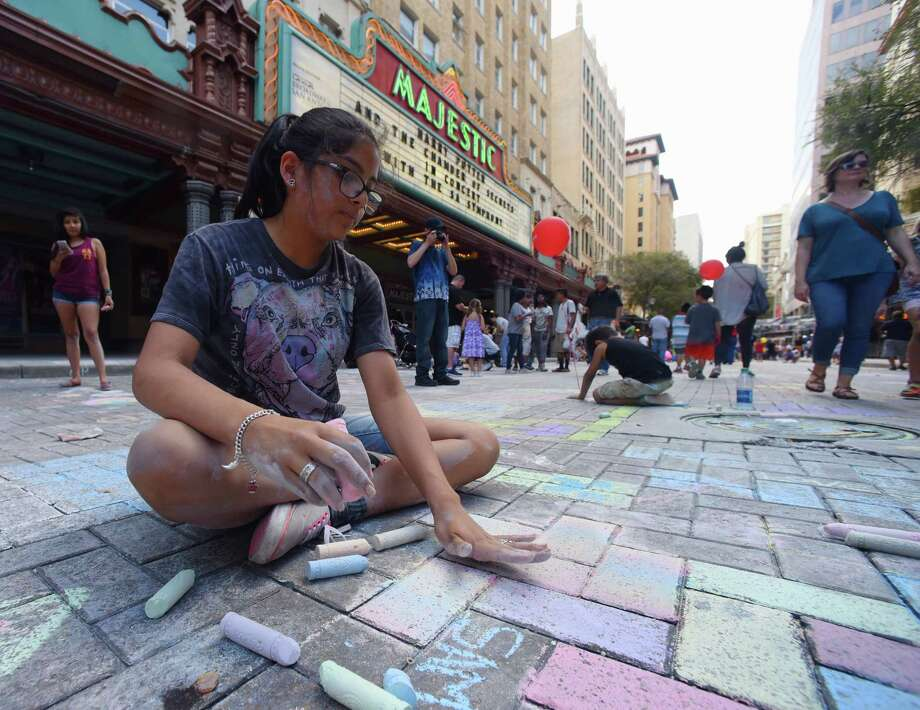 Desiree Benavides, 13, works on her art during the Artpace Chalk It Up event along Houston Street in downtown San Antonio on Saturday, Oct. 14, 2017. Local artists teamed up with the public to create chalk murals and standalone pieces on the sidewalk. Music and food added to the festive atmosphere of the event. Photo: Billy Calzada, San Antonio Express-News / San Antonio Express-News