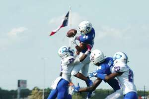 Dickinson's Bryon Broussard (25) breaks up a pass to Clear Springs' Isaiah Bibb (24) Saturday, Oct. 14 at CCISD Challenger Columbia Stadium.