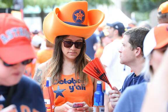 Fans dressed in Orange and Blue for the ALCS Game 2 Saturday, Oct. 14, 2017, in Houston. ( Steve Gonzales / Houston Chronicle )