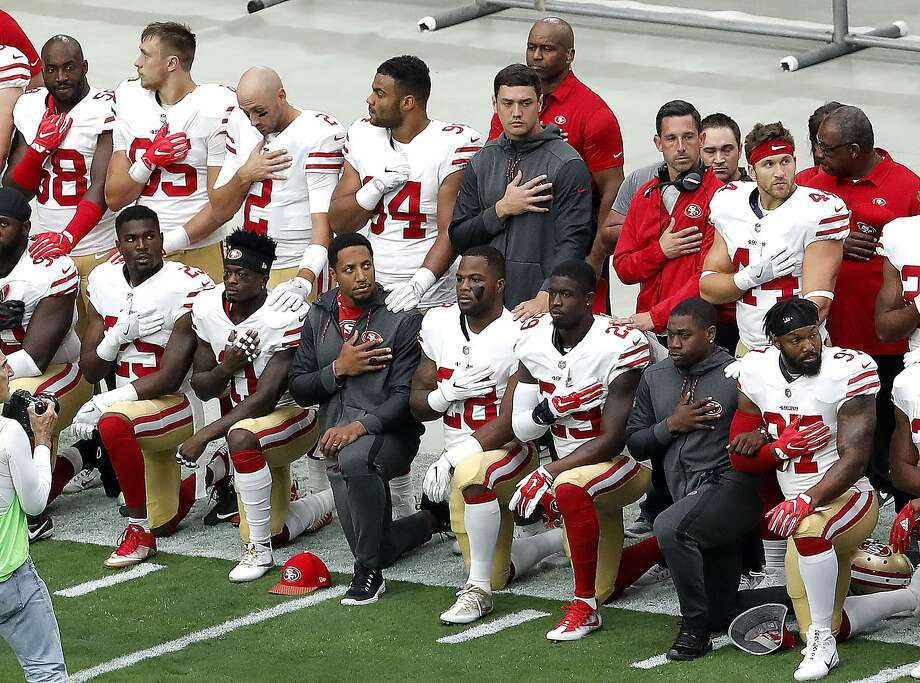 Members of the San Francisco 49ers kneel during the national anthem as others stand prior to an NFL football game against the Arizona Cardinals, Sunday, Oct. 1, 2017, in Glendale, Ariz. Photo: Matt York, Associated Press