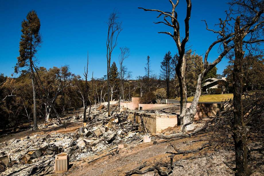Houses on Deer Hollow Drive are seen destroyed in Napa, Calif. Saturday, October 14, 2017. Photo: Mason Trinca, Special To The Chronicle