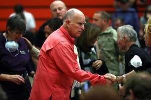 California Governor Jerry Brown greets a community member before a Sonoma County Fire Response and Recovery community meeting at Santa Rosa High School in Santa Rosa, Calif., on Saturday, October 14, 2017.