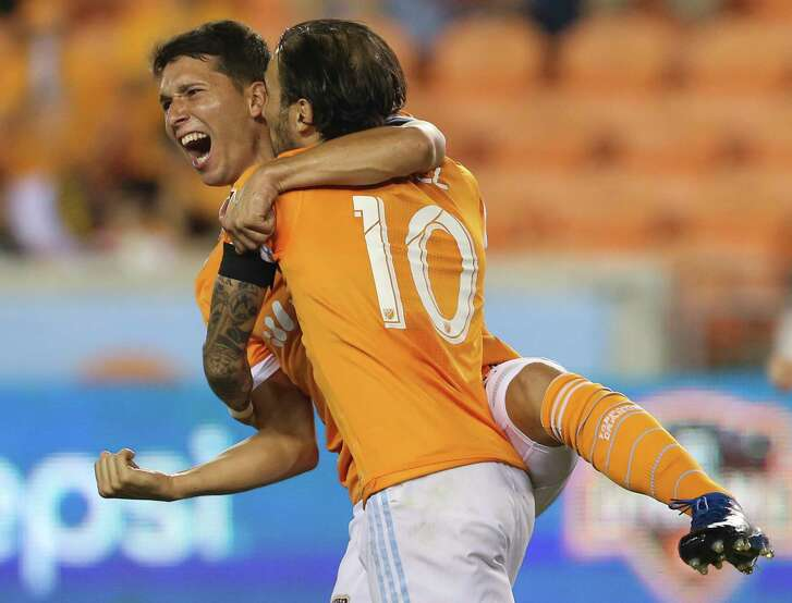 Dynamo midfielder Tomas Martinez, left, and Vicente Sanchez celebrate Martinez's goal in the 63rd minute against Sporting Kansas City that tied the match at BBVA Compass Stadium on Wednesday. The Dynamo went on to win.