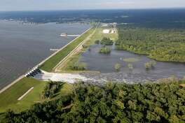 Water flows from the Lake Conroe spillway after heavy rain from Hurricane Harvey caused the lake to rise and led the San Jacinto River Authority to release water from the dam, ultimately flooding many homes.