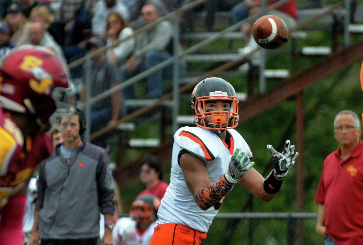 Ridgefield's Jackson Mitchell receives a pass during football action against St. Joseph in Trumbull, Conn. on Saturday Oct. 14, 2017.