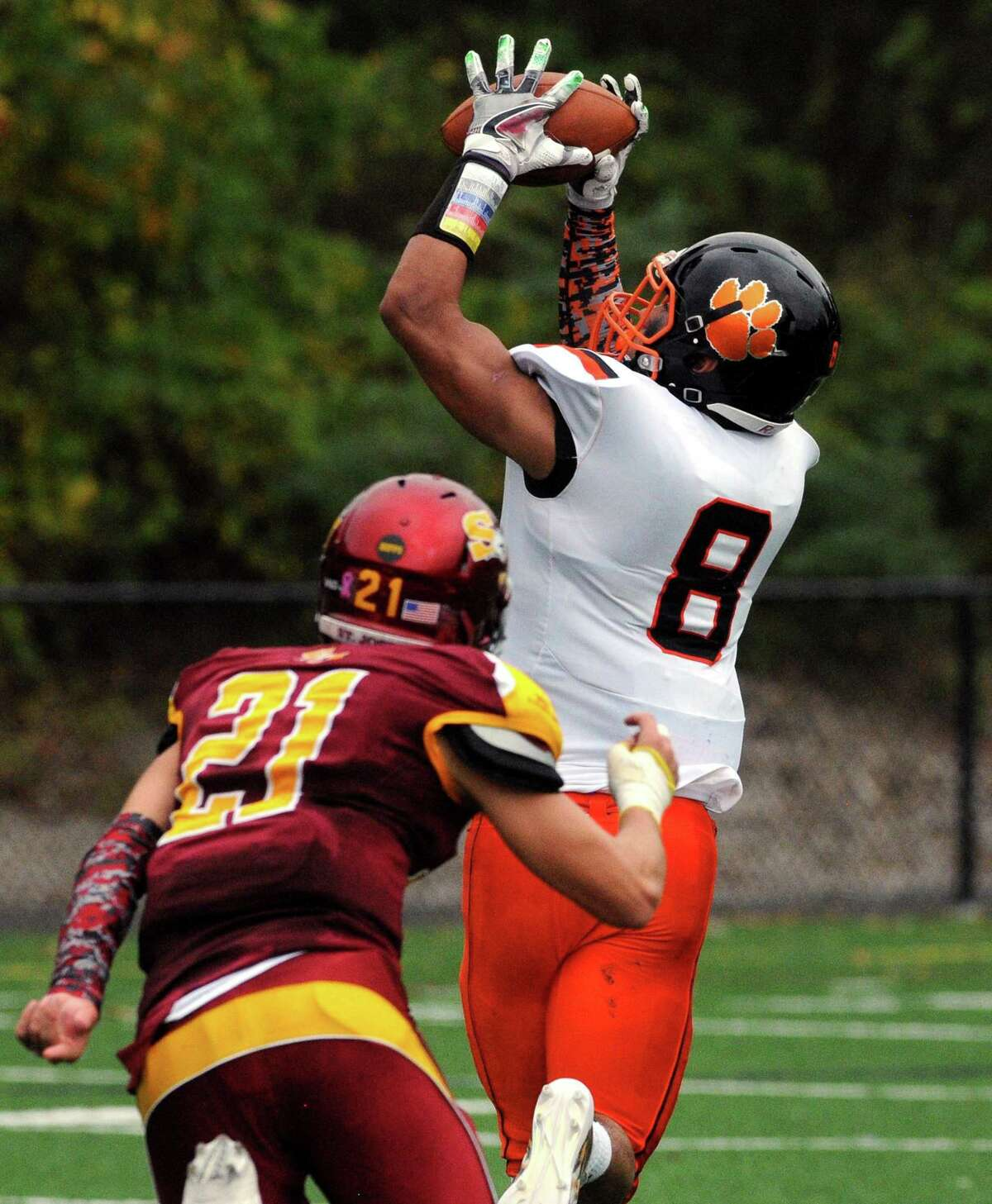 Ridgefield's Jackson Mitchell completes a pass which he took to the end zone to score a touchdown during football action against St. Joseph in Trumbull, Conn. on Saturday Oct. 14, 2017.