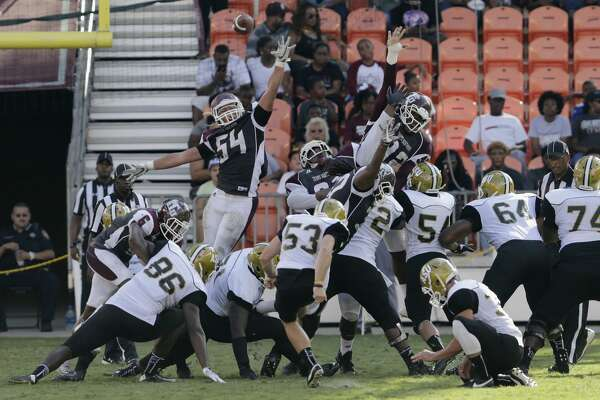 Alabama State Hornets place kicker Hunter Hanson (53) kicks a field goal defended by Texas Southern Tigers linebacker Julian Marcantel (54), Texas Southern Tigers fullback Bradlee Warrick (32), and Texas Southern Tigers defensive lineman Ike Onwuasoanya (92) in the third quarter during the NCAA football game between the Alabama State Hornets and the Texas Southern Tigers at BBVA Compass Stadium in Houston, TX on Saturday, October 14, 2017.