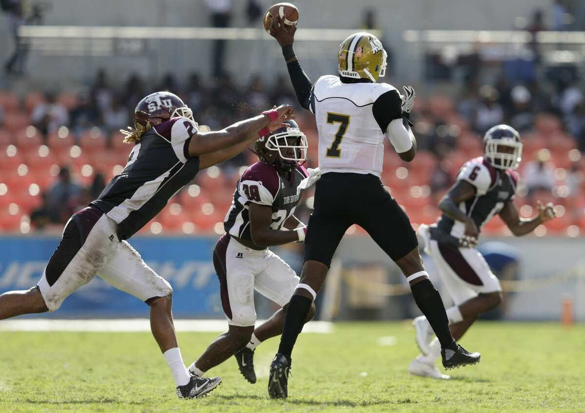 Texas Southern Tigers defensive lineman Anthony Johnson (2) and defensive back Marquis Walker (38) pressure Alabama State Hornets quarterback Darryl Pearson Jr. (7) in the third quarter during the NCAA football game between the Alabama State Hornets and the Texas Southern Tigers at BBVA Compass Stadium in Houston, TX on Saturday, October 14, 2017.