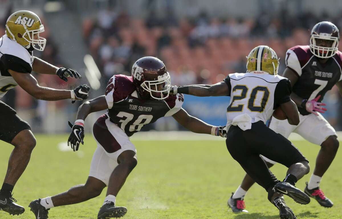 Texas Southern Tigers defensive back Marquis Walker (38) tackles Alabama State Hornets running back Ezra Gray (20) in the third quarter during the NCAA football game between the Alabama State Hornets and the Texas Southern Tigers at BBVA Compass Stadium in Houston, TX on Saturday, October 14, 2017.