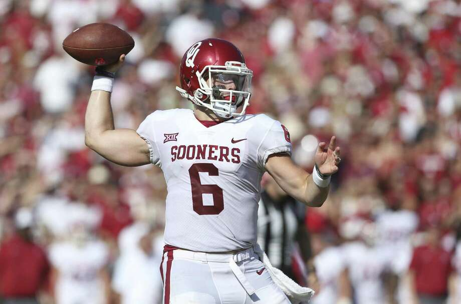 Sooner quarterback Baker Mayfield coils to throw in the first half as Texas plays Oklahoma in the Red River Showdown at the Cotton Bowl on October 14, 2017. Photo: Tom Reel, Staff / San Antonio Express-News / 2017 SAN ANTONIO EXPRESS-NEWS