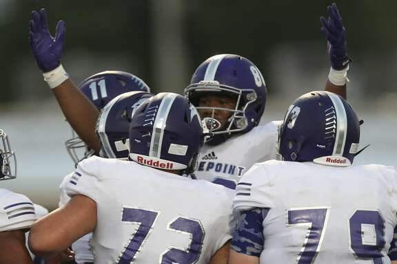 Ridge Point players celebrate tight end Mustapha Muhammad's touchdown during the first quarter of the game against Dickinson at Sam Vitanza Stadium Friday, Sept. 22, 2017, in Dickinson. ( Yi-Chin Lee / Houston Chronicle )
