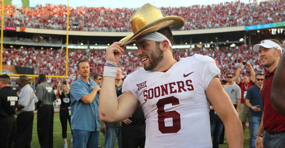 DALLAS, TX - OCTOBER 14:  Baker Mayfield #6 of the Oklahoma Sooners wears the Golden Hat Trophy after the 29-24 win over the Texas Longhorns at Cotton Bowl on October 14, 2017 in Dallas, Texas.  (Photo by Richard W. Rodriguez/Getty Images) Photo: Richard Rodriguez/Getty Images