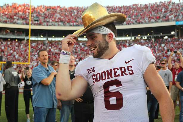 DALLAS, TX - OCTOBER 14:  Baker Mayfield #6 of the Oklahoma Sooners wears the Golden Hat Trophy after the 29-24 win over the Texas Longhorns at Cotton Bowl on October 14, 2017 in Dallas, Texas.  (Photo by Richard W. Rodriguez/Getty Images)