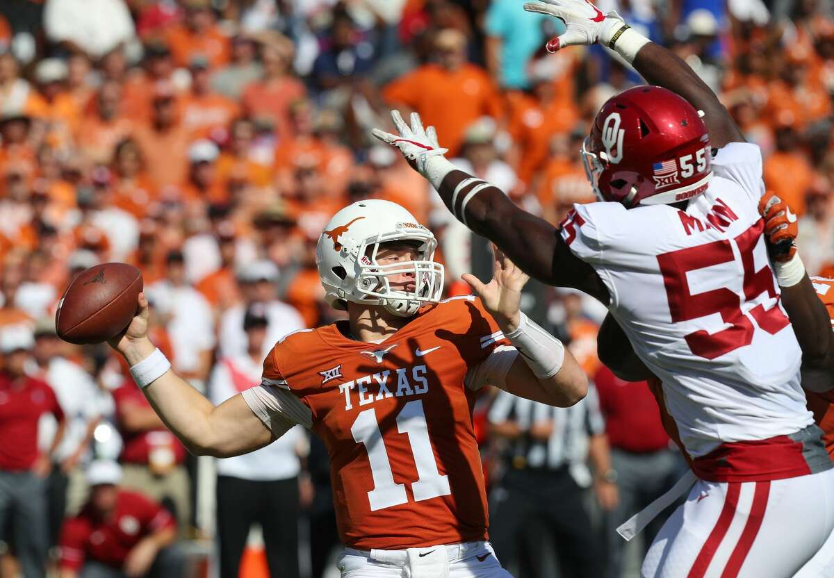 DALLAS, TX - OCTOBER 14: Sam Ehlinger #11 of the Texas Longhorns passes the ball under pressure from Kenneth Mann #55 of the Oklahoma Sooners at Cotton Bowl on October 14, 2017 in Dallas, Texas. (Photo by Richard Rodriguez/Getty Images)