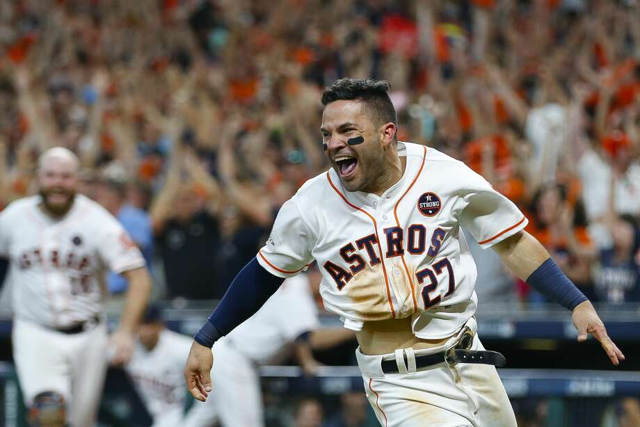 Houston Astros second baseman Jose Altuve (27) celebrates after safely sliding into home to give the Astros a 2-1 win over the New York Yankees after a double by shortstop Carlos Correa (1) in the ninth inning of Game 2 of the ALCS at Minute Maid Park on Saturday, Oct. 14, 2017, in Houston. ( Brett Coomer / Houston Chronicle ) Photo: Brett Coomer/Houston Chronicle