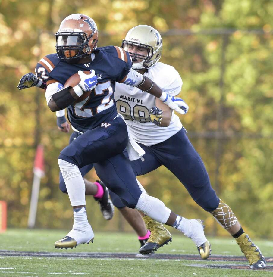 Western's Kahalil Patterson (22) stays out of the reach of Maritime's Kyle Johnson (88) in the football game between Massachusetts Maritime Academy and Western Connecticut State University on Saturday evening, October 14, 2017 at the Westside Athletic Complex, in Danbury, Conn. Photo: H John Voorhees III / Hearst Connecticut Media / The News-Times