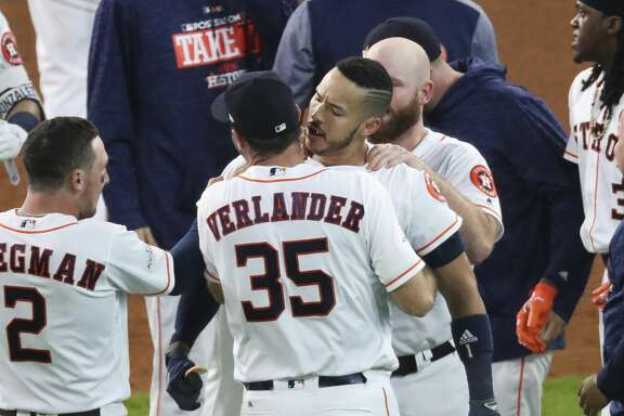 Houston Astros shortstop Carlos Correa (1), who hit a game winning RBI double to bring in second baseman Jose Altuve (27), celebrates with starting pitcher Justin Verlander (35), who pitched nine innings, as they beat the New York Yankees 2-1 in Game 2 of the ALCS at Minute Maid Park Saturday, Oct. 14, 2017 in Houston. ( Michael Ciaglo / Houston Chronicle)